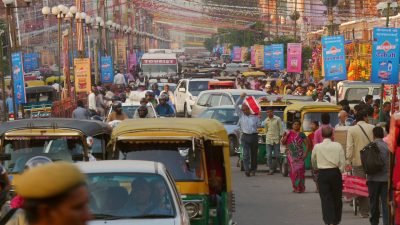 Busy traffic and pedestrians street in India